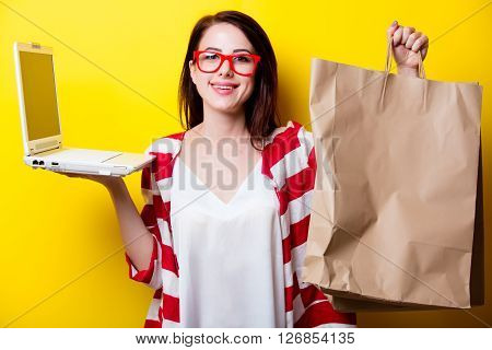 Portrait Of The Young Woman With Shopping Bags And Laptop