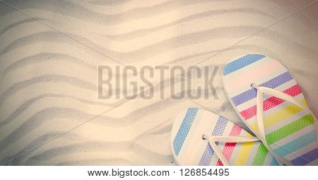 colorful sandals and fishnet lying on the sand ** Note: Soft Focus at 100%, best at smaller sizes