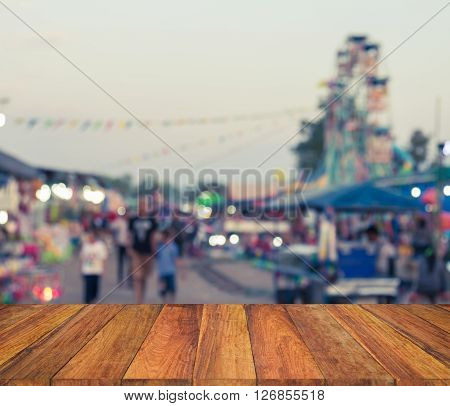 Old Wood Texture With Blurred  People Walk In The Fair Background