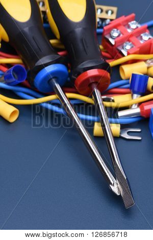 Electrical component kit to use in electrical installations on blue metal background
