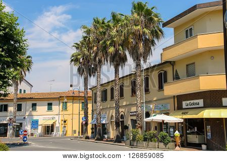Vada Italy - June 29 2015: Vada Italy - June 29 2015: Buildings on Piazza Garibaldi in small town Vada on the coast of the Ligurian Sea. Province Livorno Tuscany region of Italy