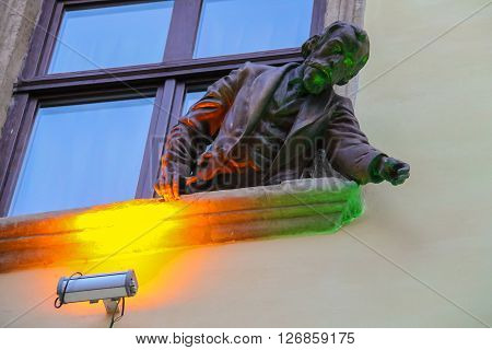 Lviv Ukraine - July 5 2014: Sculpture of Ignacy Lukasiewicz from window of pub-museum Gas Lamp. Jan Zech and Ignacy Lukasiewicz invented gas lamp in 1853