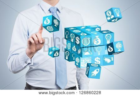 Businessman resolving cube puzzle on light background