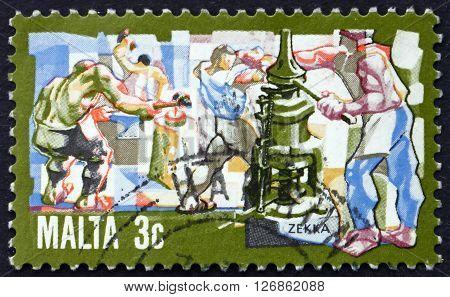MALTA - CIRCA 1981: a stamp printed in Malta shows Minting Coins circa 1981