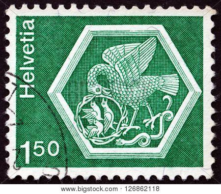 SWITZERLAND - CIRCA 1974: a stamp printed in the Switzerland shows Ceiling medalion Bird Feeding Nestlings Stein and Rhein Convent circa 1974