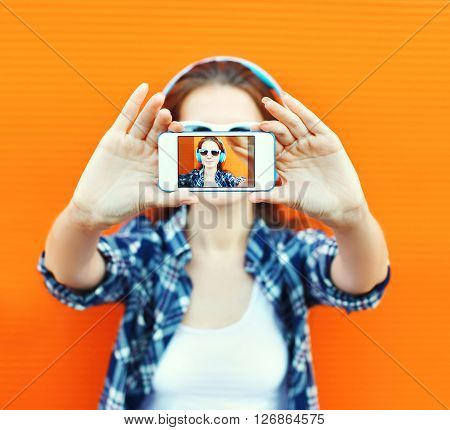 Closeup Woman Makes Self-portrait On Smartphone View Of Screen