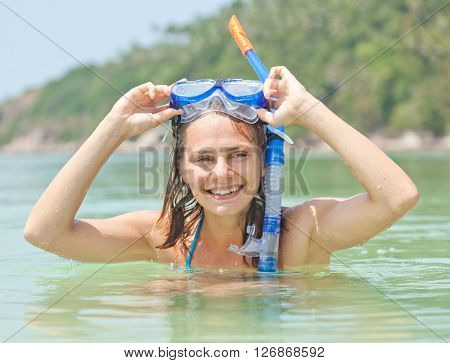 Young Woman With A Mask For Snorkeling On A Tropical Beach. Sport And Active Holiday In Vacation