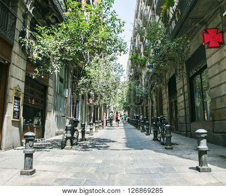 SPAIN, BARCELONA, JUNE, 27, 2015 - Narrow streets of the Gothic Quarter in Barcelona, Catalonia, Spain.