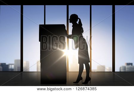 business, logistics, transportation and shipment people concept - silhouette of businesswoman moving boxes over office window background