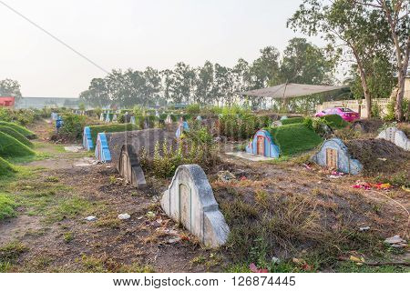 CHONBURI, THAILAND - APRIL 2 : The graveyard at Jing Gung Cemetery for Ancestor Worshipping and Sacrificial offering in the Qingming Festival on April 2, 2016 at Chonburi Thailand.