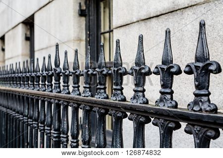 Wrought Iron Fence Along Limestone Building in Savannah