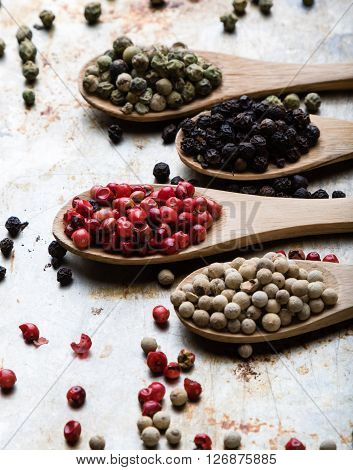 Color Peppercorn Seeds On Wooden Spoons