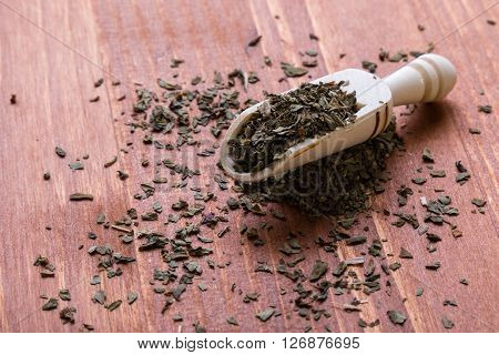 Oregano Condiment On Wooden Table