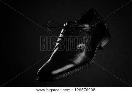 Black Shoe On Black Background