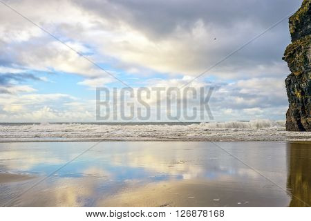 wet sand and cliff reflections on the wild atlantic way in Ballybunion Ireland