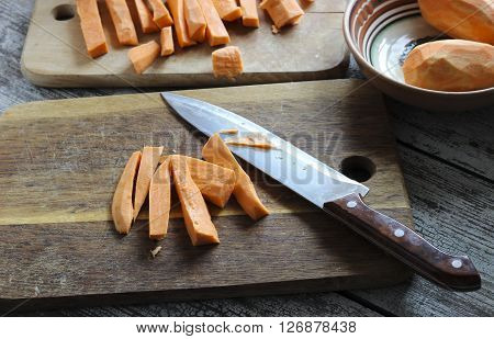 Fresh Cut Slices Of Sweet Potatoes Made Into Fries