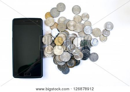 Mobile phone with indian currency set on a white background. Denoting payment through mobile and mobile wallets. Pile of old and new coins with phone