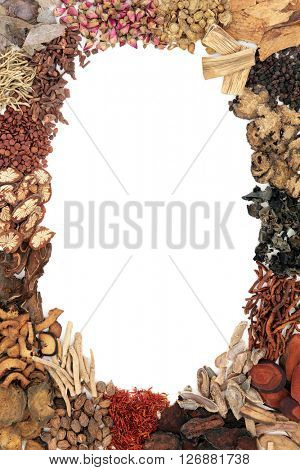 Chinese herb selection used in traditional herbal medicine forming an abstract border over white background.