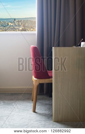 chair near the window in bedroom