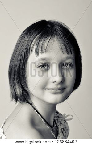 Portrait of the girl - teenager. He looks into the camera.