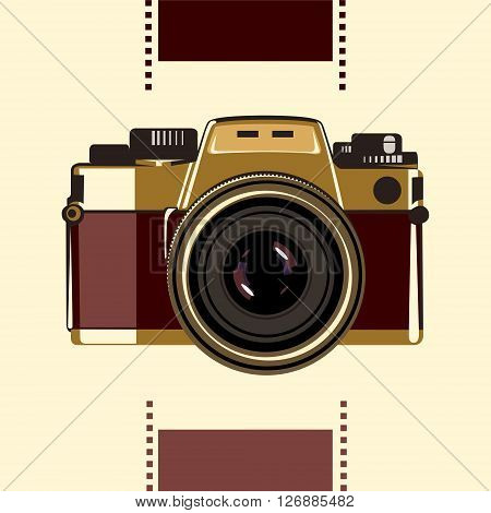 An old-school photo camera in gold-vinous colours
