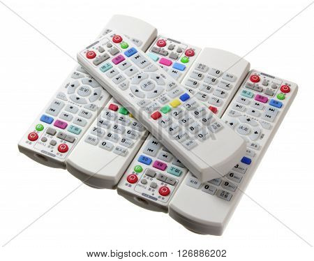 Pile of Remote Controls on White Background