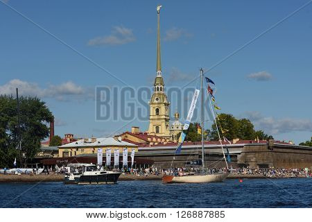 ST. PETERSBURG, RUSSIA - AUGUST 15, 2015: People on the beach during the International marine festival in the Peter and Paul fortress. The fest is main event of the Great St. Petersburg Sailing Week