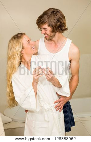 Cute couple happy to see the positive pregnancy test in the bathroom