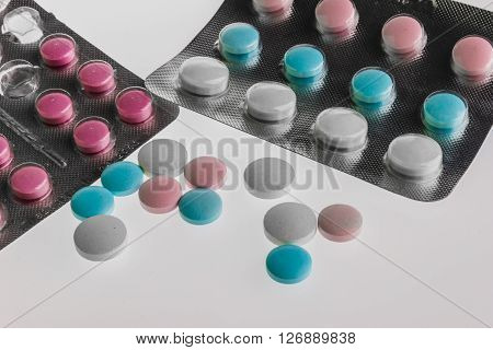 colored pills isolated on the white background