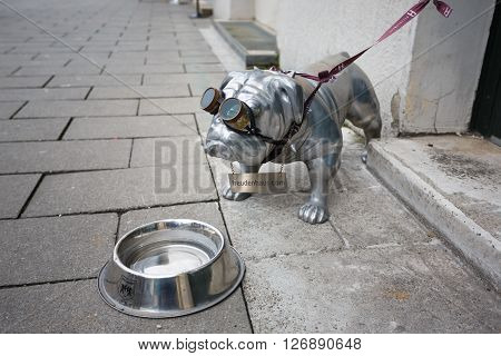 Munich Germany - January 08 2016: Metal monument bulldog with bowl located in Odeon square of Munich