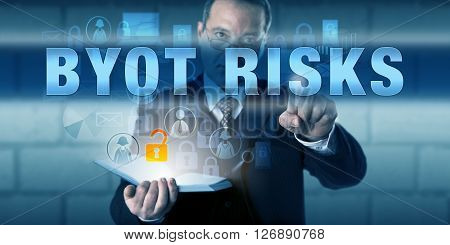 Business director is pressing BYOT RISKS on a virtual touch screen interface. Business trend metaphor and information technology concept for the risks of Bring Your Own Technology practices.