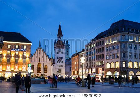 Munich Germany - January 08 2016: People walking on the Marienplatz nearby the Old Town Hall on the east side of Marienplatz one of the most famous place of the city evening time