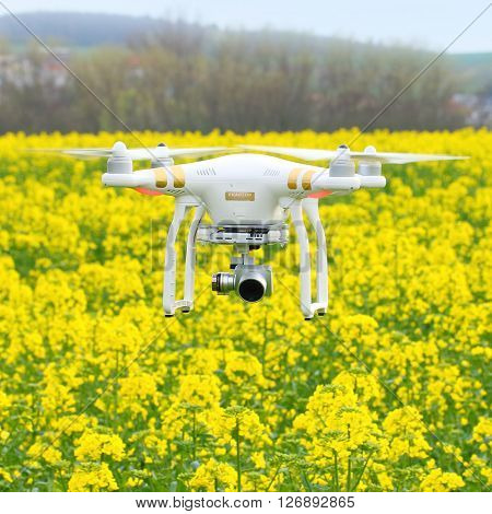 PILSEN CZECH REPUBLIC - APRIL 22, 2016: Drone quadrocopter Dji Phantom 3 Professional with camera. New tool for farmers use drones to inspect of cultivated fields. Modern technology in agriculture.