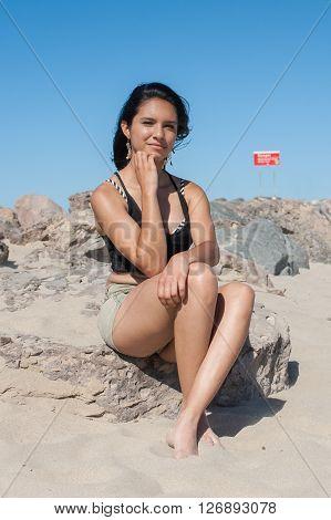 Sexy female on the rocks in Ventura.