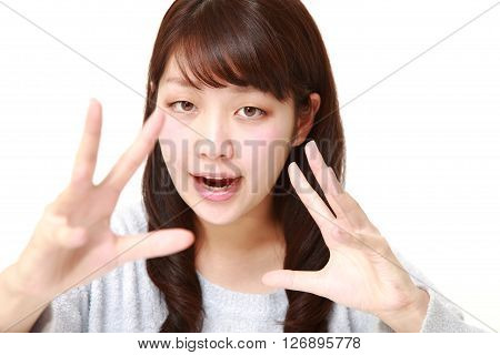 young Japanese woman with supernatural power on white background
