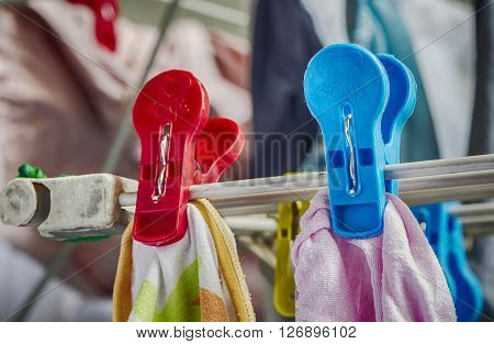 Plastic clothespins on clothes line in close up view.