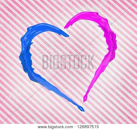 Colorful heart made of paint splash on striped background