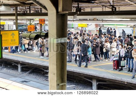 TOKYO - MARCH 31, 2016: The Yamanote Line (Yamanote-sen) is Tokyo's most important train line.People waiting for rail train at Tokyo main railway station in March 31, 2016 Tokyo, Japan.