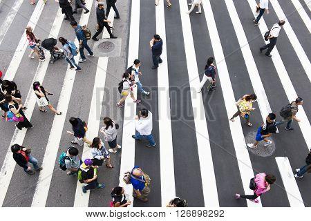 TAIPEI TAIWAN 22 MARCH 2014: Zebra pedestrian walking through the streets of Taipei on the road 22 MARCH 2014 in taipei taiwan