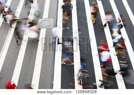 Busy city people on zebra crossing street