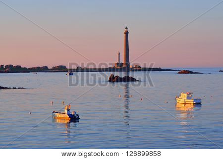 Sunset Sea View Of Île Vierge Lighthouse, Yachts And Boats In Brittany, France
