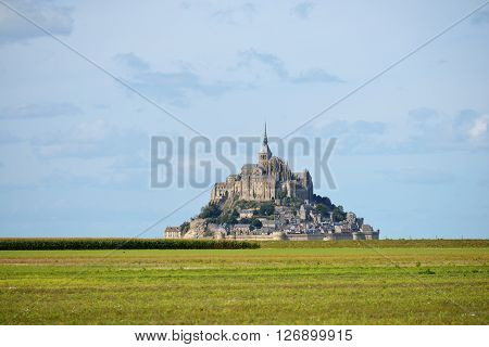 View Of Mont Saint Michel, France, With A Green Field