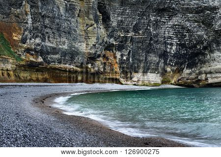 View Of An Ocean Bay With Gray Cliffs In Normandy, France