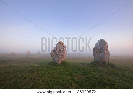 Two Menhirs At Camaret Sur Mer At Sunrise During Fog