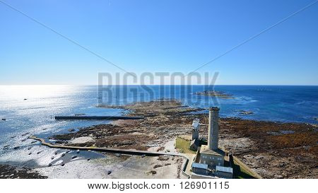Aerial View Of A Lighthouse And Ocean Coast In Brittany, France
