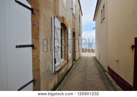 Narrow street passage at Ile de Sein France