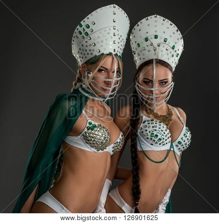Image of sexy beauties posing in costumes for erotic dance