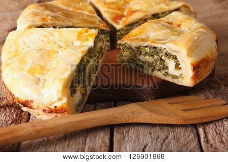 Tasty Sliced Greek Pie With Spinach And Cheese Close-up. Horizontal