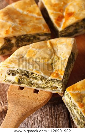 Greek Pie With Spinach And Cheese Spanakopita Close-up. Vertical