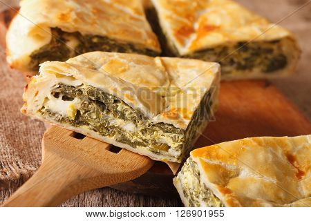 Greek Pie With Spinach And Cheese Spanakopita Close-up. Horizontal